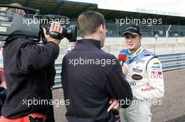 12.09.2004 Dijon, France, Sunday 12 September 2004, Norbert Siedler, AUT, ADM Motorsport, portrait, being interviewed by DSF, German Television - SUPERFUND EURO 3000 Championship Rd 7, Circuit Dijon-Prenois, France, FRA - SUPERFUND COPYRIGHT FREE editorial use only