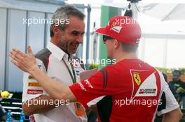 (L to R): Beat Zehnder (SUI) Sauber F1 Team Manager with Kimi Raikkonen (FIN) Ferrari. 13.03.2014. Formula 1 World Championship, Rd 1, Australian Grand Prix, Albert Park, Melbourne, Australia, Preparation Day.