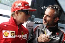 (L to R): Kimi Raikkonen (FIN) Ferrari with Beat Zehnder (SUI) Sauber F1 Team Manager. 05.07.2014. Formula 1 World Championship, Rd 9, British Grand Prix, Silverstone, England, Qualifying Day.