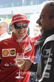(L to R):Kimi Raikkonen (FIN) Ferrari with Beat Zehnder (SUI) Sauber F1 Team Manager. 05.07.2014. Formula 1 World Championship, Rd 9, British Grand Prix, Silverstone, England, Qualifying Day.