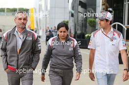 (L to R): Beat Zehnder (SUI) Sauber F1 Team Manager with Monisha Kaltenborn (AUT) Sauber Team Principal and Adrian Sutil (GER) Sauber. 06.07.2014. Formula 1 World Championship, Rd 9, British Grand Prix, Silverstone, England, Race Day.