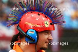 A marshal with a mohican Michael Schumacher (GER) themed  helmet. 27.07.2014. Formula 1 World Championship, Rd 11, Hungarian Grand Prix, Budapest, Hungary, Race Day.