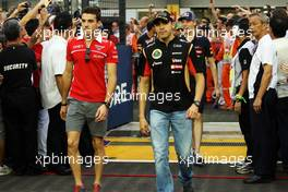 (L to R): Jules Bianchi (FRA) Marussia F1 Team and Pastor Maldonado (VEN) Lotus F1 Team on the drivers parade. 21.09.2014. Formula 1 World Championship, Rd 14, Singapore Grand Prix, Singapore, Singapore, Race Day.