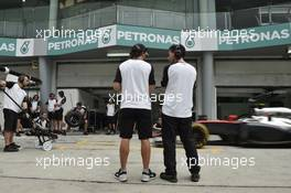 (L to R): Fernando Alonso (ESP) McLaren with Andrea Stella (ITA) McLaren Race Engineer. 26.03.2015. Formula 1 World Championship, Rd 2, Malaysian Grand Prix, Sepang, Malaysia, Thursday.