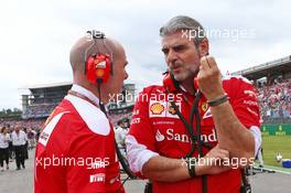 (L to R): Jock Clear (GBR) Ferrari Engineering Director with Maurizio Arrivabene (ITA) Ferrari Team Principal on the grid. 31.07.2016. Formula 1 World Championship, Rd 12, German Grand Prix, Hockenheim, Germany, Race Day.