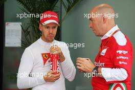 (L to R): Sebastian Vettel (GER) Ferrari with Jock Clear (GBR) Ferrari Engineering Director. 01.10.2016. Formula 1 World Championship, Rd 16, Malaysian Grand Prix, Sepang, Malaysia, Saturday.