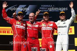The podium (L to R): Kimi Raikkonen (FIN) Ferrari, second; Jock Clear (GBR) Ferrari Engineering Director; Sebastian Vettel (GER) Ferrari, race winner; Valtteri Bottas (FIN) Mercedes AMG F1, third.  30.07.2017. Formula 1 World Championship, Rd 11, Hungarian Grand Prix, Budapest, Hungary, Race Day.