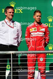 (L to R): James Allison (GBR) Mercedes AMG F1 Technical Director on the podium with Sebastian Vettel (GER) Ferrari. 22.10.2017. Formula 1 World Championship, Rd 17, United States Grand Prix, Austin, Texas, USA, Race Day.