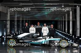 The Mercedes AMG F1 W09 with (L to R): James Allison (GBR) Mercedes AMG F1 Technical Director; Valtteri Bottas (FIN) Mercedes AMG F1; Toto Wolff (GER) Mercedes AMG F1 Shareholder and Executive Director; Lewis Hamilton (GBR) Mercedes AMG F1; and Andy Cowell (GBR) Mercedes-Benz High Performance Powertrains Managing Director. 22.02.2018. Mercedes AMG F1 W09 Launch, Silverstone, England.