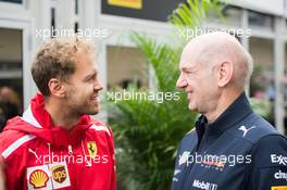 (L to R): Sebastian Vettel (GER) Ferrari with Adrian Newey (GBR) Red Bull Racing Chief Technical Officer. 20.10.2018. Formula 1 World Championship, Rd 18, United States Grand Prix, Austin, Texas, USA, Qualifying Day.