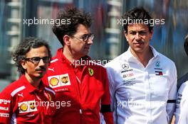 (L to R): Laurent Mekies (FRA) Ferrari Sporting Director with Mattia Binotto (ITA) Ferrari Team Principal and Toto Wolff (GER) Mercedes AMG F1 Shareholder and Executive Director. 17.03.2019. Formula 1 World Championship, Rd 1, Australian Grand Prix, Albert Park, Melbourne, Australia, Race Day.