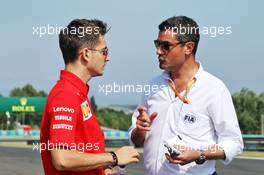 (L to R): Charles Leclerc (MON) Ferrari with Michael Masi (AUS) FIA Race Director. 01.08.2019. Formula 1 World Championship, Rd 12, Hungarian Grand Prix, Budapest, Hungary, Preparation Day.