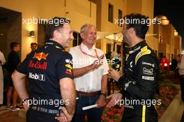 (L to R): Christian Horner (GBR) Red Bull Racing Team Principal with Dr Helmut Marko (AUT) Red Bull Motorsport Consultant and Daniel Ricciardo (AUS) Renault F1 Team. 30.11.2019. Formula 1 World Championship, Rd 21, Abu Dhabi Grand Prix, Yas Marina Circuit, Abu Dhabi, Qualifying Day.