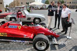 Zak Brown (USA) McLaren Executive Director with the 1982 Ferrari 126C2 driven by Patrick Tambay on display in the paddock - Sotherby's.  30.11.2019. Formula 1 World Championship, Rd 21, Abu Dhabi Grand Prix, Yas Marina Circuit, Abu Dhabi, Qualifying Day.