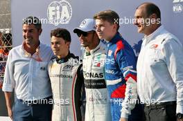 (L to R): Michael Masi (AUS) FIA Race Director; Nyck De Vries (NLD) ART Grand Prix, F2 Champion; Lewis Hamilton (GBR) Mercedes AMG F1, F1 World Champion; Robert Shwartzman (RUS) Prema Racing, F3 Champion; Bruno Michel (FRA) F2 and F3 CEO. 01.12.2019. Formula 1 World Championship, Rd 21, Abu Dhabi Grand Prix, Yas Marina Circuit, Abu Dhabi, Race Day.