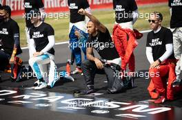 Drivers on the grid with their 'End Racism' pledge Lewis Hamilton (GBR) Mercedes AMG F1. 09.08.2020. Formula 1 World Championship, Rd 5, 70th Anniversary Grand Prix, Silverstone, England, Race Day.