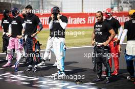 Drivers on the grid with their 'End Racism' pledge - Lewis Hamilton (GBR) Mercedes AMG F1 and Nicholas Latifi (CDN) Williams Racing. 09.08.2020. Formula 1 World Championship, Rd 5, 70th Anniversary Grand Prix, Silverstone, England, Race Day.