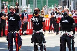 (L to R): Max Verstappen (NLD) Red Bull Racing; Lewis Hamilton (GBR) Mercedes AMG F1; and Valtteri Bottas (FIN) Mercedes AMG F1, on the grid. 09.08.2020. Formula 1 World Championship, Rd 5, 70th Anniversary Grand Prix, Silverstone, England, Race Day.