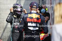 (L to R): Lewis Hamilton (GBR) Mercedes AMG F1 with race winner Max Verstappen (NLD) Red Bull Racing in parc ferme. 09.08.2020. Formula 1 World Championship, Rd 5, 70th Anniversary Grand Prix, Silverstone, England, Race Day.