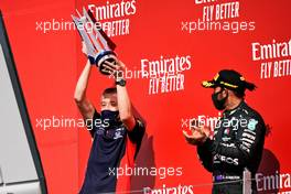 (L to R): Will Courtenay, Red Bull Racing Head of Race Strategy celebrates on the podium with Lewis Hamilton (GBR) Mercedes AMG F1.                                09.08.2020. Formula 1 World Championship, Rd 5, 70th Anniversary Grand Prix, Silverstone, England, Race Day.