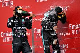 (L to R): Lewis Hamilton (GBR) Mercedes AMG F1 celebrates his second position on the podium with third placed team mate Valtteri Bottas (FIN) Mercedes AMG F1. 09.08.2020. Formula 1 World Championship, Rd 5, 70th Anniversary Grand Prix, Silverstone, England, Race Day.