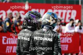 (L to R): Lewis Hamilton (GBR) Mercedes AMG F1 with team mate Valtteri Bottas (FIN) Mercedes AMG F1 in parc ferme. 09.08.2020. Formula 1 World Championship, Rd 5, 70th Anniversary Grand Prix, Silverstone, England, Race Day.