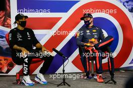 (L to R): Lewis Hamilton (GBR) Mercedes AMG F1 and Max Verstappen (NLD) Red Bull Racing in the post race FIA Press Conference. 09.08.2020. Formula 1 World Championship, Rd 5, 70th Anniversary Grand Prix, Silverstone, England, Race Day.