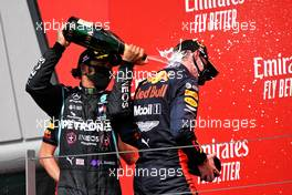 (L to R): Lewis Hamilton (GBR) Mercedes AMG F1 celebrates his second position on the podium with race winner Max Verstappen (NLD) Red Bull Racing. 09.08.2020. Formula 1 World Championship, Rd 5, 70th Anniversary Grand Prix, Silverstone, England, Race Day.