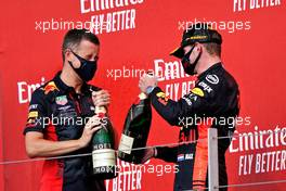 Max Verstappen (NLD) Red Bull Racing (Right) celebrates on the podium with Will Courtenay, Red Bull Racing Head of Race Strategy. 09.08.2020. Formula 1 World Championship, Rd 5, 70th Anniversary Grand Prix, Silverstone, England, Race Day.