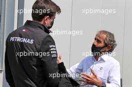 (L to R): Toto Wolff (GER) Mercedes AMG F1 Shareholder and Executive Director with Alain Prost (FRA) Renault F1 Team Non-Executive Director. 09.08.2020. Formula 1 World Championship, Rd 5, 70th Anniversary Grand Prix, Silverstone, England, Race Day.