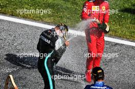 Race winner Valtteri Bottas (FIN) Mercedes AMG F1 celebrates on the podium with Lando Norris (GBR) McLaren and Charles Leclerc (MON) Ferrari. 05.07.2020. Formula 1 World Championship, Rd 1, Austrian Grand Prix, Spielberg, Austria, Race Day.