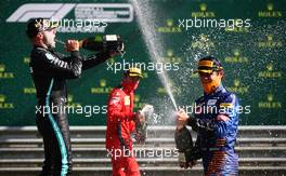 Race winner Valtteri Bottas (FIN) Mercedes AMG F1 celebrates on the podium with Lando Norris (GBR) McLaren.