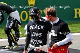 (L to R): Lewis Hamilton (GBR) Mercedes AMG F1 and Sebastian Vettel (GER) Ferrari on the grid. 30.08.2020. Formula 1 World Championship, Rd 7, Belgian Grand Prix, Spa Francorchamps, Belgium, Race Day.