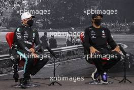 (L to R): Valtteri Bottas (FIN) Mercedes AMG F1 and Lewis Hamilton (GBR) Mercedes AMG F1 in the post race FIA Press Conference. 30.08.2020. Formula 1 World Championship, Rd 7, Belgian Grand Prix, Spa Francorchamps, Belgium, Race Day.