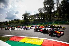 Alexander Albon (THA) Red Bull Racing RB16 and Esteban Ocon (FRA) Renault F1 Team RS20 at the start of the race. 30.08.2020. Formula 1 World Championship, Rd 7, Belgian Grand Prix, Spa Francorchamps, Belgium, Race Day.
