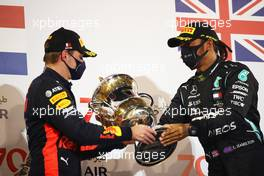 (L to R): Max Verstappen (NLD) Red Bull Racing and race winner Lewis Hamilton (GBR) Mercedes AMG F1 celebrate on the podium. 29.11.2020. Formula 1 World Championship, Rd 15, Bahrain Grand Prix, Sakhir, Bahrain, Race Day.