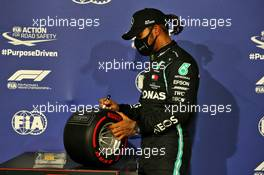 Lewis Hamilton (GBR) Mercedes AMG F1 celebrates with the Pirelli Pole Position Award in parc ferme. 28.11.2020. Formula 1 World Championship, Rd 15, Bahrain Grand Prix, Sakhir, Bahrain, Qualifying Day.