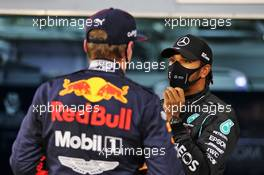 Lewis Hamilton (GBR) Mercedes AMG F1 in qualifying parc ferme with Max Verstappen (NLD) Red Bull Racing. 28.11.2020. Formula 1 World Championship, Rd 15, Bahrain Grand Prix, Sakhir, Bahrain, Qualifying Day.