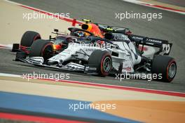 Pierre Gasly (FRA) AlphaTauri AT01 and Alexander Albon (THA) Red Bull Racing RB16. 28.11.2020. Formula 1 World Championship, Rd 15, Bahrain Grand Prix, Sakhir, Bahrain, Qualifying Day.
