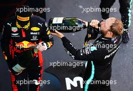 Valtteri Bottas (FIN) Mercedes AMG F1 celebrates his third position with the champagne on the podium with second placed Max Verstappen (NLD) Red Bull Racing. 16.08.2020. Formula 1 World Championship, Rd 6, Spanish Grand Prix, Barcelona, Spain, Race Day.
