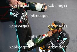Race winner Lewis Hamilton (GBR) Mercedes AMG F1 celebrates with the champagne on the podium with team mate Valtteri Bottas (FIN) Mercedes AMG F1. 16.08.2020. Formula 1 World Championship, Rd 6, Spanish Grand Prix, Barcelona, Spain, Race Day.