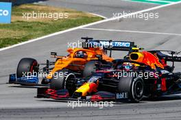 Alexander Albon (THA) Red Bull Racing RB16 and Carlos Sainz Jr (ESP) McLaren MCL35 battle for position. 16.08.2020. Formula 1 World Championship, Rd 6, Spanish Grand Prix, Barcelona, Spain, Race Day.