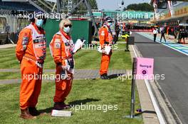 Circuit atmosphere - marshals in the pits. 31.07.2020. Formula 1 World Championship, Rd 4, British Grand Prix, Silverstone, England, Practice Day.