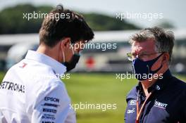 (L to R): Toto Wolff (GER) Mercedes AMG F1 Shareholder and Executive Director with Otmar Szafnauer (USA) Racing Point F1 Team Principal and CEO. 31.07.2020. Formula 1 World Championship, Rd 4, British Grand Prix, Silverstone, England, Practice Day.