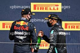 Race winner Lewis Hamilton (GBR) Mercedes AMG F1 celebrates on the podium with Max Verstappen (NLD) Red Bull Racing.                                02.08.2020. Formula 1 World Championship, Rd 4, British Grand Prix, Silverstone, England, Race Day.