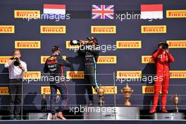 The podium (L to R): Gilles Pironi (FRA) Mercedes AMG F1; Max Verstappen (NLD) Red Bull Racing, second; Lewis Hamilton (GBR) Mercedes AMG F1, race winner; Charles Leclerc (MON) Ferrari, third.                                02.08.2020. Formula 1 World Championship, Rd 4, British Grand Prix, Silverstone, England, Race Day.