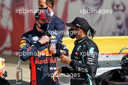 Max Verstappen (NLD) Red Bull Racing with race winner Lewis Hamilton (GBR) Mercedes AMG F1 in parc ferme.                                02.08.2020. Formula 1 World Championship, Rd 4, British Grand Prix, Silverstone, England, Race Day.