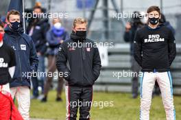Kevin Magnussen (DEN) Haas F1 Team and George Russell (GBR) Williams Racing on the grid. 11.10.2020. Formula 1 World Championship, Rd 11, Eifel Grand Prix, Nurbugring, Germany, Race Day.