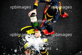 Max Verstappen (NLD) Red Bull Racing celebrates his second position with Daniel Ricciardo (AUS) Renault F1 Team on the podium. 11.10.2020. Formula 1 World Championship, Rd 11, Eifel Grand Prix, Nurbugring, Germany, Race Day.