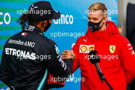 Race winner Lewis Hamilton (GBR) Mercedes AMG F1 is presented with the helmet of Michael Schumacher (GER) by Mick Schumacher (GER) in parc ferme after equalling the record for the number of F1 victories. 11.10.2020. Formula 1 World Championship, Rd 11, Eifel Grand Prix, Nurbugring, Germany, Race Day.